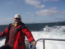 Rae is riding Dive Tutekaka's high speed boat out to the Poor Knights Islands in a rough sea.